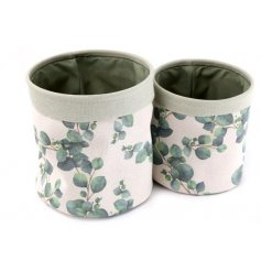 A set of 2 stylish and practical canvas storage baskets each with a eucalyptus print