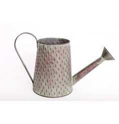 An overly distressed decorative metal garden watering can with an added diamond ridge embossment