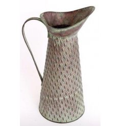 An overly distressed decorative metal garden jug with an added diamond ridge embossment