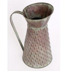 An overly distressed metal jug decoration set with a tarnished green decal and ridge embossment