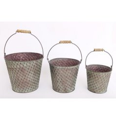 An overly distressed set of sized bucket decorations set with a tarnished green decal and ridge embossment