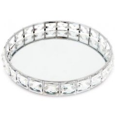 A beautifully silver mirror tray featuring a glitzy beaded surround