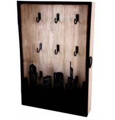 Set with a cutout City Skyline Decal, this natural wooden box also features additional hooks for key storage
