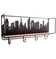 Set with a cutout City Skyline Decal, this natural wooden shelving unit also features additional hooks for storage
