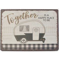 a small magnetic sign with a caravan decal and matching text decal