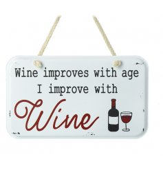 A humorous vintage metal sign with a popular wine slogan. Complete with a rope hanger.