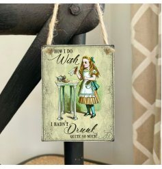 Set with a printed scene and scripted text from the Alice In Wonderland story,