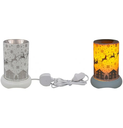 A warm glowing LED Glass Lamp featuring a beautifully illustrated Christmas Eve Winter Scene
