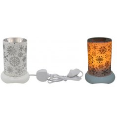 Set with a white base and Christmas Eve inspired scene print, this warm glowing LED Lamp will place perfectly in any ho