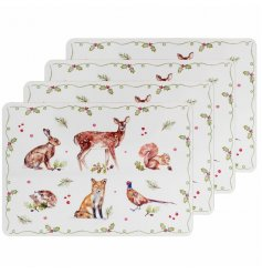 A set of 4 placemats decorated with an enchanting winter forest design including your favourite woodland animals.
