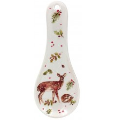 A spoon rest decorated with a watercolour Winter Forest scene