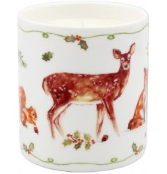 A ceramic candle pot filled with a beautifully scented candle. Decorated with enchanting woodland animals.