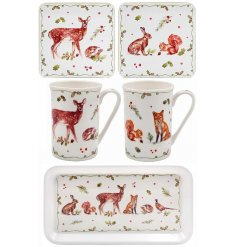 A stylish gift set featuring mugs, coasters and a tray. Each tableware item is decorated with a winter forest scene.