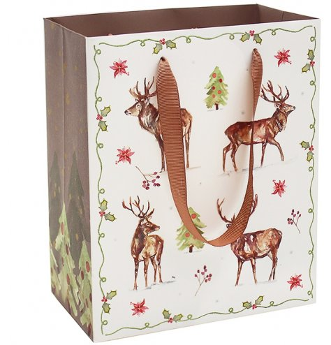 A fine quality woodland gift bag featuring a detailed stag design with decorative seasonal foliage.