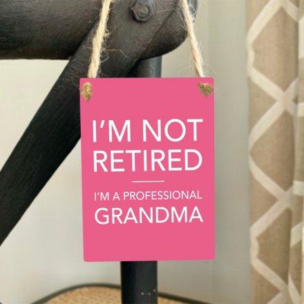I'm not retired. I'm a professional Grandma. A humorous and loving sentiment slogan plaque for Grandma.