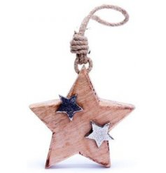 A small natural wooden hanging star decoration covered with smaller silver stars