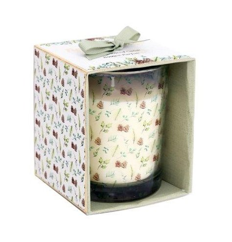 A wood sage and fig scented Wax Candle sat in a decorative display box with a matching woodland print to it