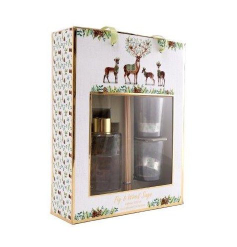 A wood sage and fig scented set that includes a reed diffuser, votive holders and tlights