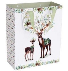 A woodland reindeer design with sage coloured details and woodland pattern presented on a medium gift bag.