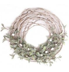 A beautiful round twig wreath complete with glittered berries and mistletoe