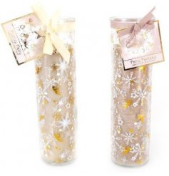 A beautifully decorated assortment of glass tube candles