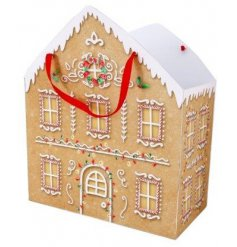 A fun and festive themed Gingerbread House inspired gift bag with added red ribbon handles