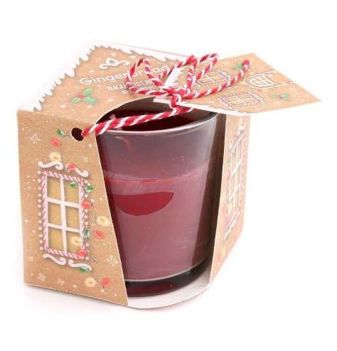 A festive scented wax candle perfectly packaged in a matching Gingerbread display box and tied with a red and white stri
