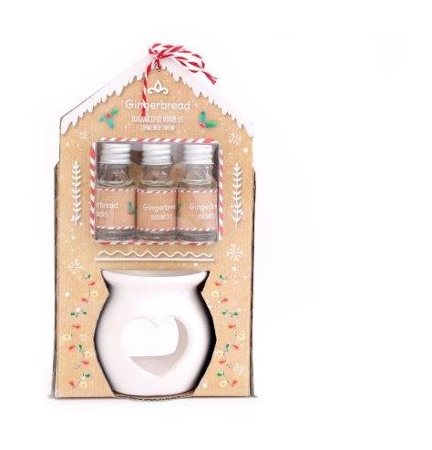 A festive scented set of essential oils and a white ceramic heart burner, set within a matching Gingerbread themed packa
