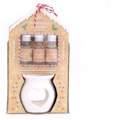 A set of 3 gingerbread scented oils complete with a white ceramic heart burner and matching styled packaging