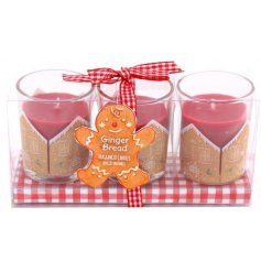A festive themed set of scented candle pots with added Gingerbread decorations on them