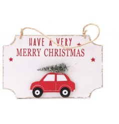A festive themed hanging wooden plaque with an added red car and tree decal complete with LED lights