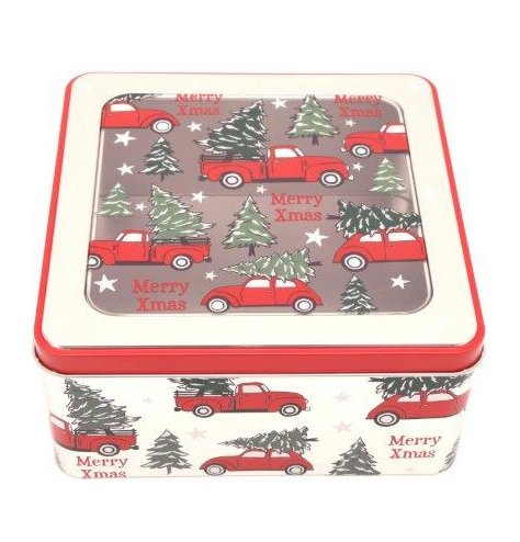A metal storage tin decorated with a festive Alpine Truck inspired print