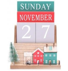 A rustic inspired wooden perpetual calendar with a traditional coloured row of houses decal on it