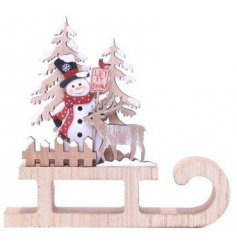 A fun and festive themed wooden Christmas Decoration set with glittery snow touches and a snowman decal