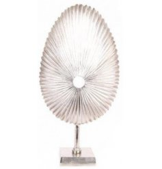 A large decorative metal fossil sculpture ornament set with a Luxe silver tone to it