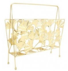 A decorative metal magazine rack set with a sleek golden toned coating and decorated with a lotus leaf print