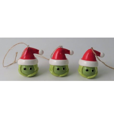 A festive little green sprout hanging decoration topped with a red hat