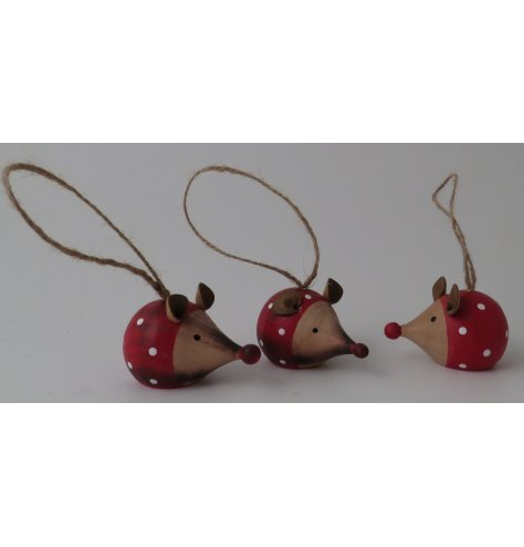 An adorable wooden mouse painted in festive red and white with polka dots.
