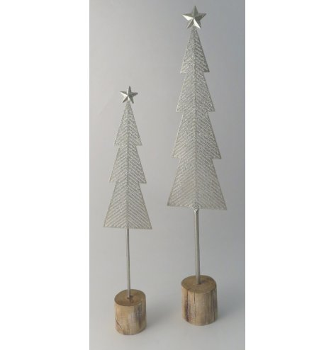 Tall shimmering silver tree with a block wooden base.