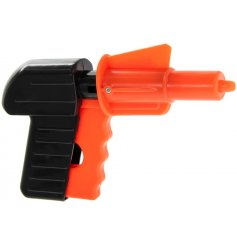 a red and black plastic spud gun from our Pocket Money Toy Range