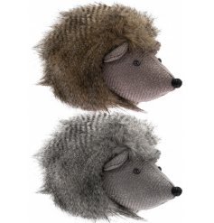 An assortment of fabric sitting hedgehog doorstops complete with fuzzy faux fur trimmings