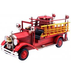 A vintage red fire engine ornament, sure to place perfectly in any study!