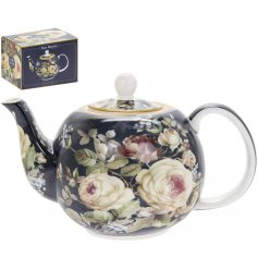 Covered with navy blue hues and subtle blush pinks, this beautifully decorated teapot will be sure to place perfectly in