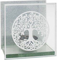 A gorgeous glass Tlight holder featuring a beautiful tree of life decal and glittery backing