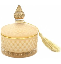 this Desire Noir Candle features a stylish ridged decal and tassel finish