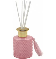 A luxe themed Reed Diffuser set with a diamond ridge decal and added tassel feature