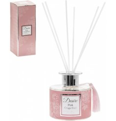 A delightfully scented reed diffuser complete with a pretty pink tone