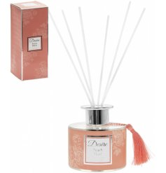 A delightfully scented reed diffuser complete with a pretty peach tone