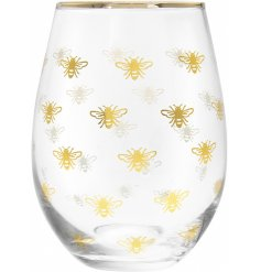 Decorated with a golden bee decal, this sleek stemless glass will be sure to place perfectly in any kitchen or dining r
