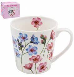 Covered with a floral decal, this fine china mug is a wonderful gift idea to give to any friend or family member